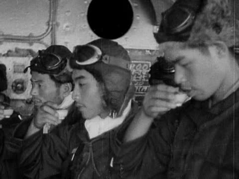 black and white close up four japanese kamikaze pilots drinking sake in ceremony before mission - pacific war video stock e b–roll