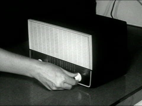 1958 black and white close up hand turning knobs on radio/ audio - radio stock videos & royalty-free footage