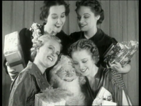 Black and white close up of 4 women surrounding Santa Claus / NO AUDIO