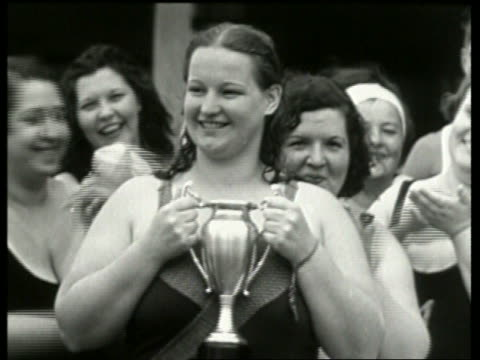 vidéos et rushes de black and white close up of heavy woman in swimsuit holding trophy / no audio - award