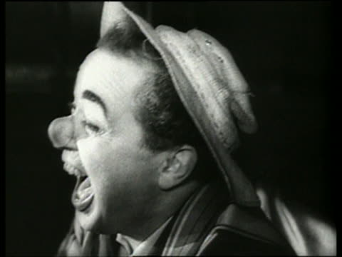 black and white close up of man in clown nose laughing in circus / germany / audio - extreme close up stock-videos und b-roll-filmmaterial