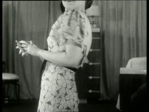 black and white close up of woman modeling nightgown in bedroom / no audio - nightdress stock videos & royalty-free footage