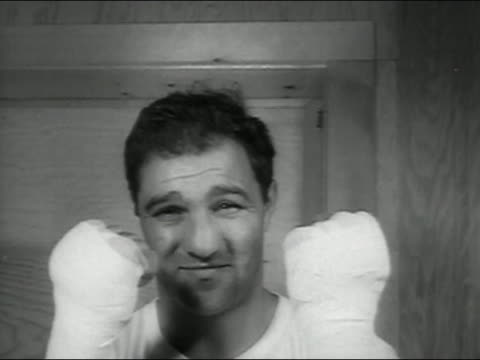 1954 black and white close up rocky marciano punching at cam / audio - 1954 stock videos and b-roll footage