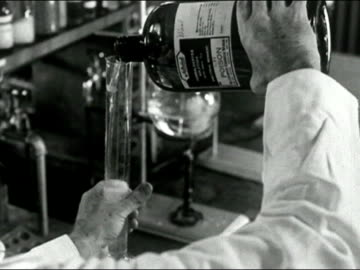 1939 black and white close up scientist pouring poison into large test tube/ audio - poisonous stock videos & royalty-free footage
