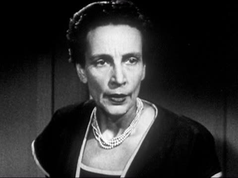 1953 Black and white Close up stern-looking woman staring with contempt and impatience / sighing and standing up / AUDIO