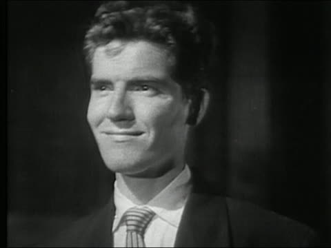 1950 black and white close up young man making pained, disappointed faces / audio - grimacing stock videos & royalty-free footage