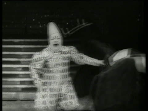 black and white clown with people in horse costumes in circus / audio - pflanzenfressend stock-videos und b-roll-filmmaterial