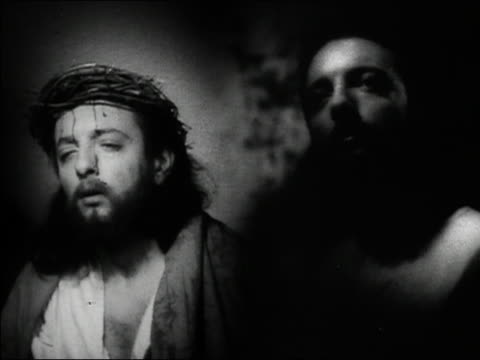 "1948 black and white composite close up jesus praying on right / montage of the passion on left from ""christ the king"" - blood stock videos & royalty-free footage"
