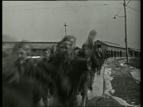 black and white crowd of soldiers running past camera / no audio - army exercise stock videos and b-roll footage
