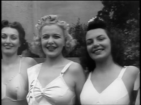 black and white early 1940s 3 contestants in swimsuit contest smiling at camera / newsreel /audio - beauty queen stock videos and b-roll footage