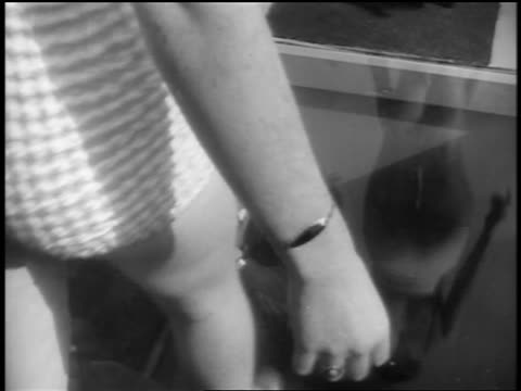 black and white early 1940s high angle close up swimsuit contest models walk over glass with filmmaker beneath it / newsreel - beauty pageant stock videos and b-roll footage