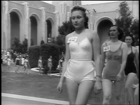 black and white early 1940s line of swimsuit contest models with numbers pinned to chests walk past camera /audio - beauty queen stock videos and b-roll footage