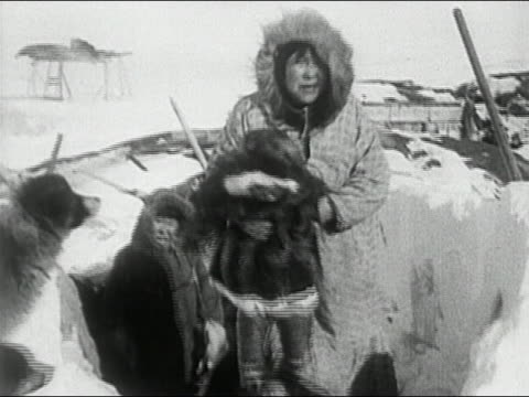 1936 black and white eskimo family emerging from igloo / alaska - inuit stock videos & royalty-free footage