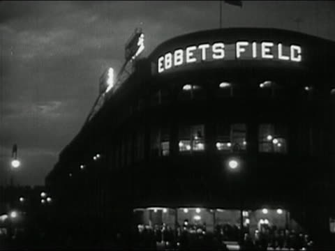 1950 black and white exterior of ebbets field at night / crowd outside entrance / brooklyn new york city - ebbets field video stock e b–roll