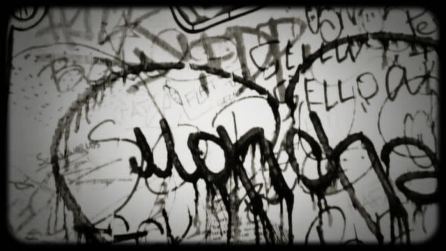 black and white film footage of graffiti decorating the wall of an urban building in paris. - newsreel stock videos & royalty-free footage