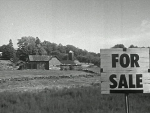 1956 black and white For Sale sign at edge of property with barn in background