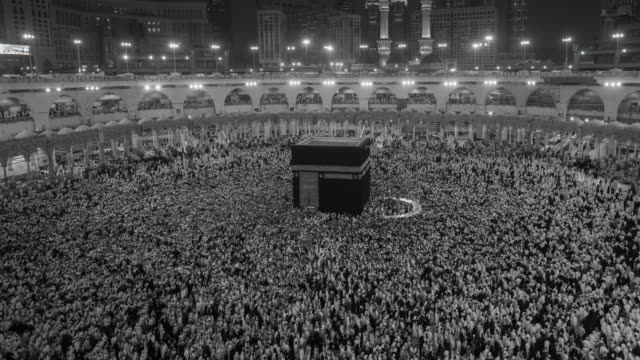 black and white group of islamic during prayer in mecca - mecca stock videos and b-roll footage