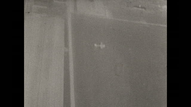 black and white gun camera footage of dive bombing runs shot by usa air force lt. c. e. nerpel over germany circa march 1945. - aircraft point of view stock videos & royalty-free footage