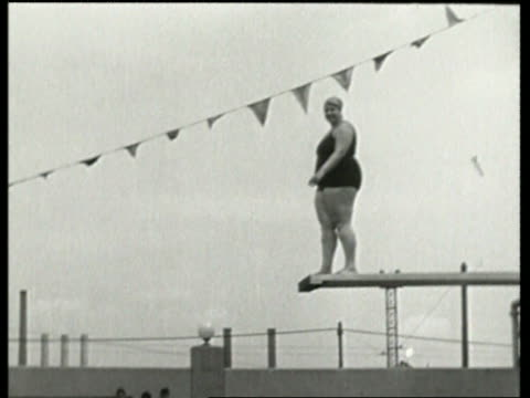 black and white heavy woman standing on diving board / no audio - badebekleidung stock-videos und b-roll-filmmaterial