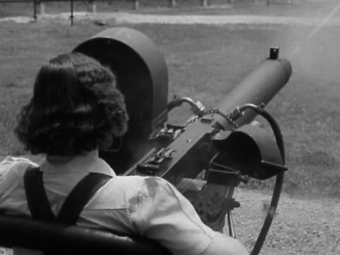 1942 black and white high angle medium shot rear view of woman testing machine gun / aberdeen proving ground maryland - machine gun stock videos & royalty-free footage