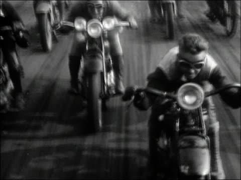 1929 black and white high angle medium shot tracking shot motorcyclists racing on ocean beach track / california - 1920 1929 stock videos & royalty-free footage