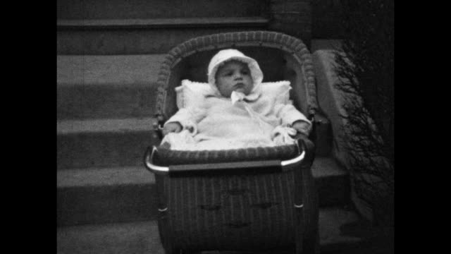 black and white home movie footage of a family in 1920s new york including a young baby - mother stock videos & royalty-free footage