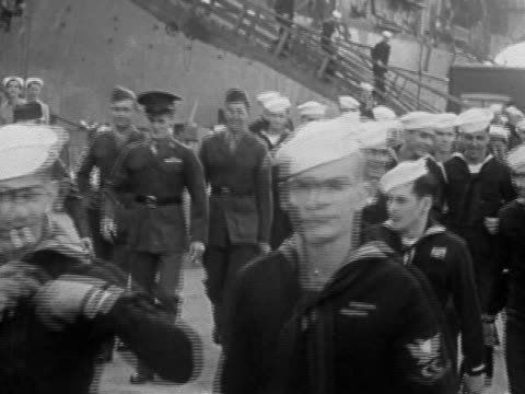 1945 black and white long shot sailors disembarking from ship and walking past the cam / new york city - sailor suit stock videos and b-roll footage