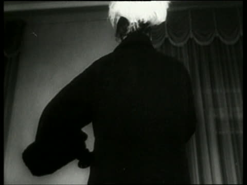 vídeos y material grabado en eventos de stock de black and white low angle close up of woman modeling coat in fashion show / italy / no audio - arts culture and entertainment