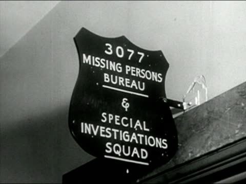 "1958 black and white low angle close up police station sign for ""missing persons bureau""/ audio - missing persons stock videos & royalty-free footage"