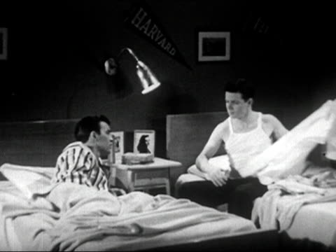 1950 black and white / male college roommates talking about girls while getting ready to go to sleep in dorm room / audio - dorm room stock videos and b-roll footage