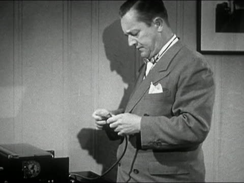 1944 black and white man plugging cord into outlet and getting shocked - plug socket stock videos and b-roll footage