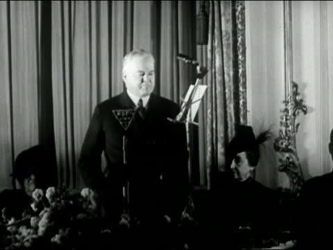 black and white medium shot herbert hoover speaking into radio microphone/ audio - kompletter anzug stock-videos und b-roll-filmmaterial