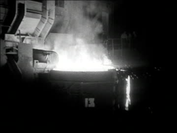 1936 black and white medium shot huge vat overflowing with molten steel - steel stock videos & royalty-free footage