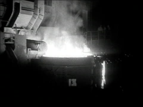 1936 black and white medium shot huge vat overflowing with molten steel - molten stock videos and b-roll footage