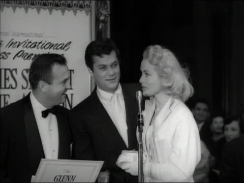 1953 black and white medium shot Janet Leigh and Tony Curtis speaking at The Glenn Miller Story premiere / Hollywood