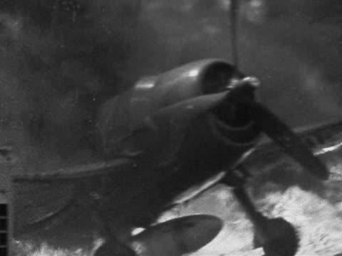 1944 black and white medium shot japanese kamikaze plane on fire on deck of uss belleau wood / philippines - philippine sea stock videos & royalty-free footage