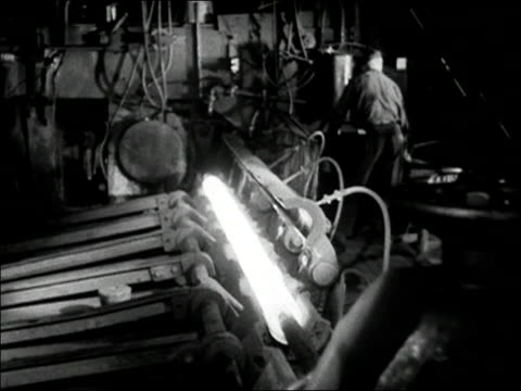 1936 black and white medium shot machine forming hot steel rod / rod rolling out of mold - prelinger stock videos & royalty-free footage