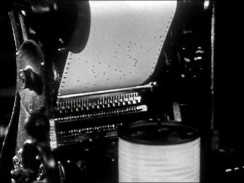 1947 Black and white medium shot machine printing out perforated paper printout