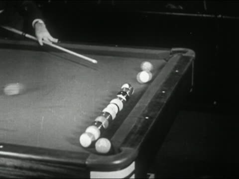 1944 black and white medium shot man doing pool trick - stunt stock videos & royalty-free footage