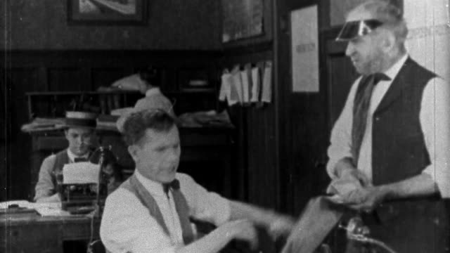 "1921 black and white medium shot man (eddie lyons) yelling at clerk in office / clutching hair / ""peace and quiet"" - journalist stock videos & royalty-free footage"