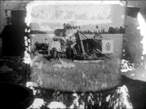 vidéos et rushes de 1936 black and white medium shot overflowing vat of molten steel / zoom in montage of industrial uses of steel - 1936