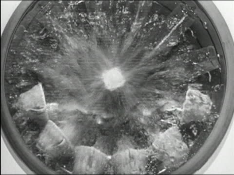 1950 black and white medium shot overhead inside of dishwasher with water spraying against glass lid / goes to slow motion - lavastoviglie video stock e b–roll