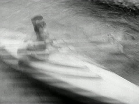 1946 black and white medium shot pan man in kayak speeding downstream and being overturned in rapids - carefree stock videos & royalty-free footage
