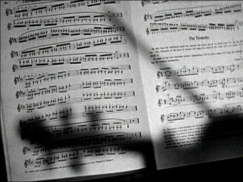 1947 black and white medium shot shadow of a violin on book of sheet music - sheet music stock videos & royalty-free footage