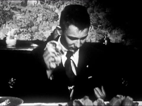 1953 black and white medium shot shame-filled boy wiping his face with napkin and looking ashamed / audio - 産みの苦しみ点の映像素材/bロール