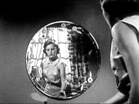 1953 black and white medium shot teenage girl combing her hair and looking at reflection in mirror / audio - eitelkeit stock-videos und b-roll-filmmaterial