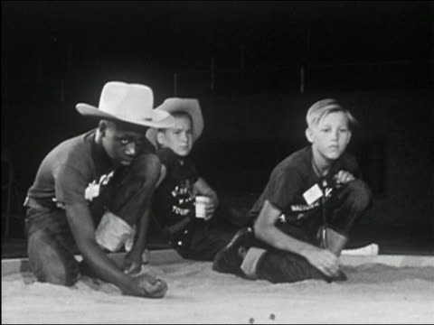 1955 black and white medium shot three boys playing marbles - marble stock videos & royalty-free footage