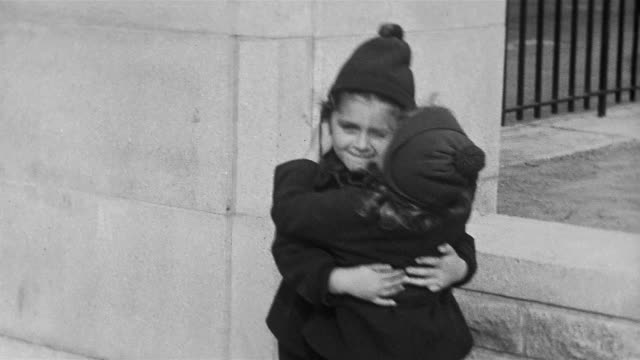 1937 black and white medium shot two little girls (janet jacoby and stephanie mattersdorf) hugging + kissing each other - home movie stock videos & royalty-free footage