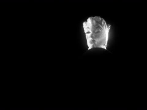1954 black and white medium shot woman wearing a double-faced mask / audio - dishonesty stock videos & royalty-free footage