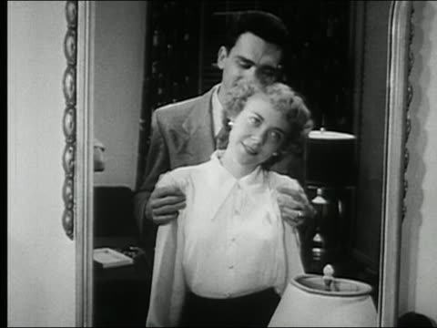 1950 black and white medium shot young couple necking in front of mirror / audio - falling in love stock videos and b-roll footage